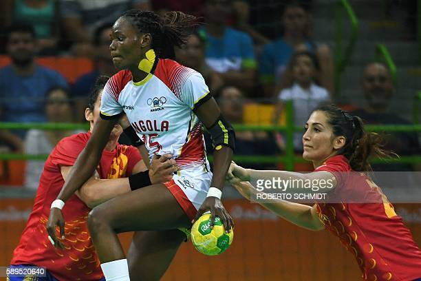 Angola's right back Azenaide Daniela Carlos jumps past Spain's left back Lara Gonzalez Ortega during the women's preliminaries Group A handball match...