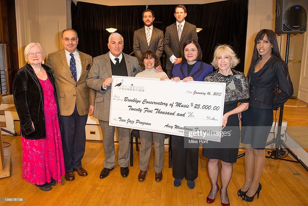 Angrea Knutson, Jacob Yahiayau, Mitch Winehouse, Janis Winehouse, Karen Geer, Julie Muraco, and Elena Ayot (Back L-R) Jason Tepper, and Joel Kress attend the Amy Winehouse Foundation Grant award presentation at Brooklyn Conservatory of Music on January 16, 2013 in New York City.