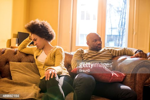 Angry African American couple ignoring each other after a fight.