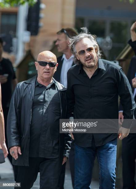 Angry Anderson and Mark Evans the original drummer attend the funeral service for AC/DC cofounder Malcolm Young at St Mary's Cathedral on November 28...