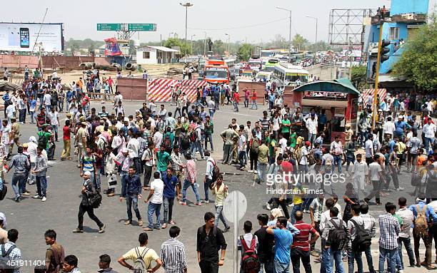 Angry aspirants blocked road during a protest after exam for jobs to state fire department were suddenly postponed on July 9 2014 in Jammu India Over...