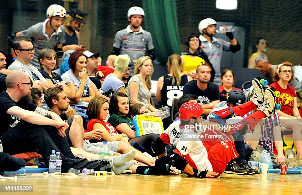 Angry Bear of Quad Guards crashes into the audience while bouting in the Men's European Cup roller derby tournament at Walker Activity Dome on August...