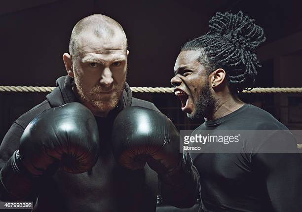 angry black boxer shouting at his opponent