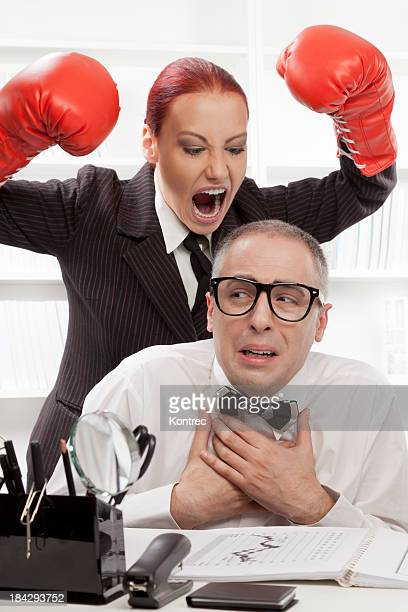 Angry boss harassing her nerdy worker