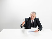 Angry businessman at desk