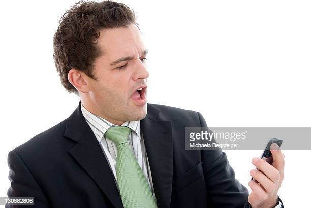 Angry businessman with mobile phone