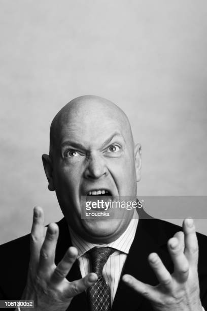 Angry Businessman Yelling and Holding Hands in Air