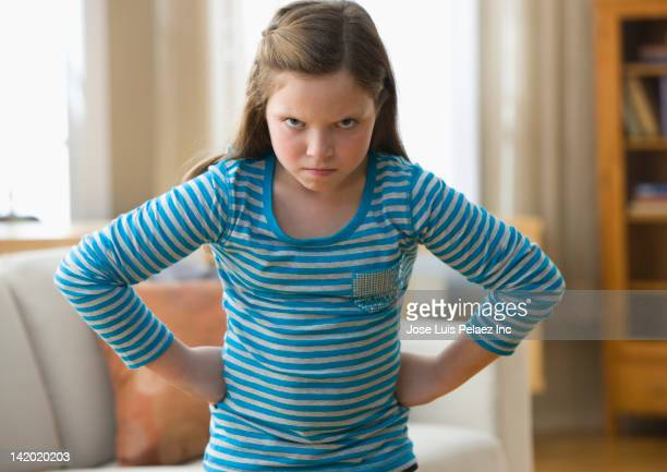 Angry Caucasian girl with hands on hips