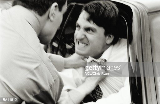 Angry driver being attacked by man through car window (soft focus B&W) : Stock Photo