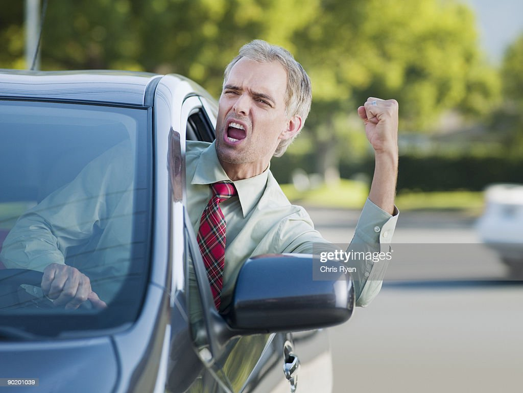 Angry driver shouting out car window : Stock Photo
