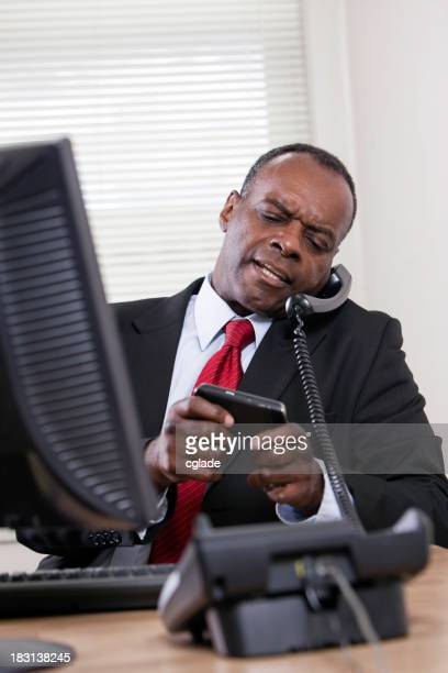 Angry Executive on Two Phones