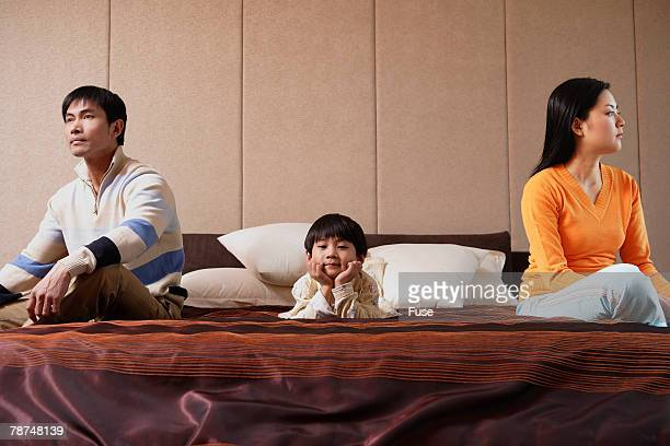 Angry Family Sitting on Bed