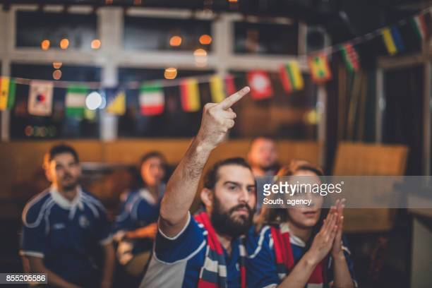 Angry fans in the bar