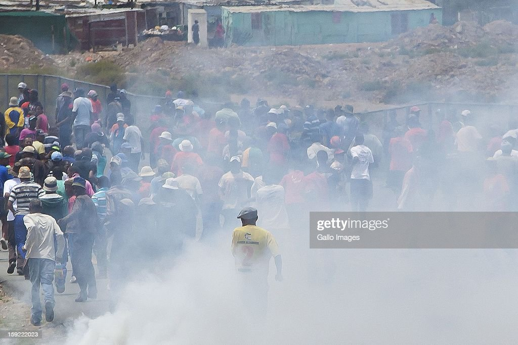 Angry farm workers in De Doorns, on January 9, 2013, in Cape Town, South Africa. Police let loose tear gas during violent demonstrations.