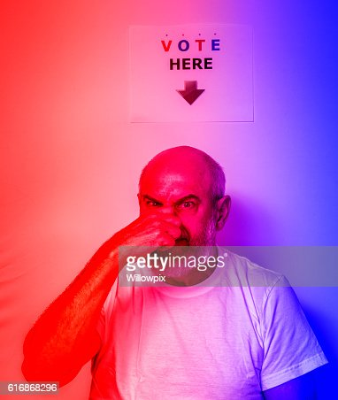 Angry Fed Up USA Independent Senior Man Voter Holding Nose : Stock Photo