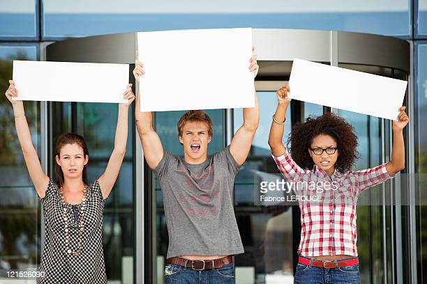 Angry friends protesting with blank placards