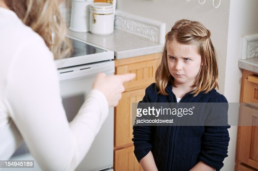 Angry girl scolded by her mother