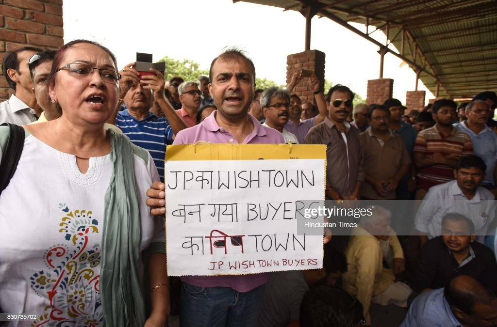 Angry home buyers protest inside Jaypee's office at sector 128, on August 12, 2017 in Noida, India. Two days after the Allahabad bench of the National Company Law Tribunal (NCLT) admitted IDBI Banks insolvency plea against Jaypee Infratech, hundreds of irate home buyers staged a protest outside Jaypee Groups after being 'cheated by a bankrupt builder'. The buyers, numbering anywhere between 5,000 and 10,000, have been camping since this morning. Most of the buyers want refund of their money.