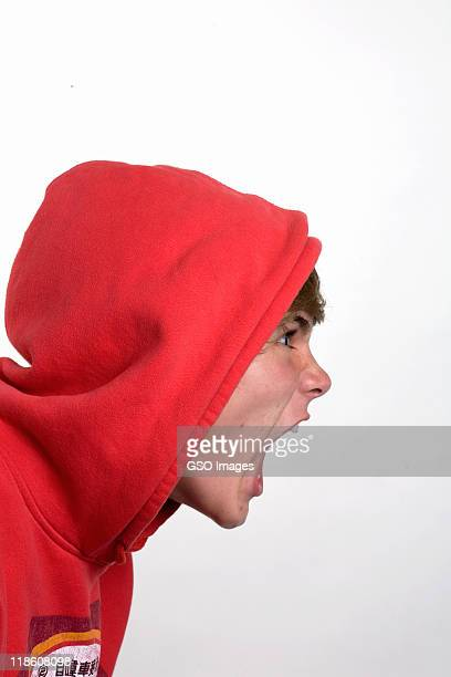 Angry hooded teen male