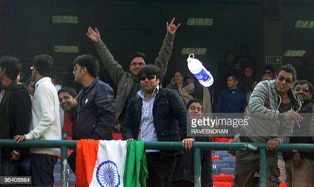 Angry Indian cricket supporters show their frustrations after the cancellation of the fifth and final One Day International cricket match at The...