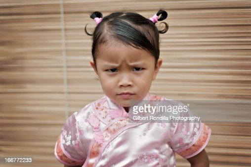 Angry Little Girl Wearing Cheongsam Stock Photo | Getty Images