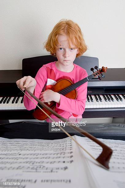 angry looking violin player