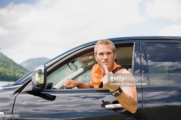 Angry man in a black car