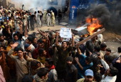 Angry Pakistani demonstrators shout slogans during a protest over alleged blasphemous remarks by a Christian in a Christian neighborhood in Badami...