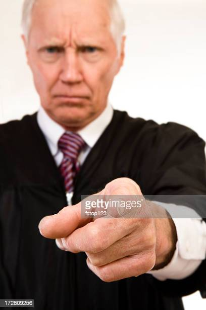 Angry pointing judge in black robe