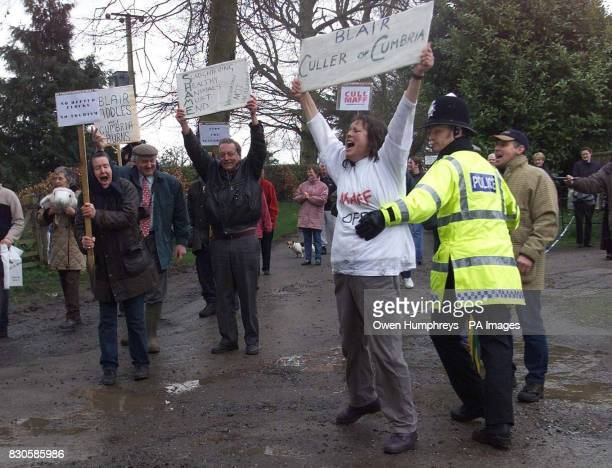 Angry scenes as people protest at the government's slaughter policy at Dalston Hall in Cumbria as Prime Minister Tony leaves a meeting with the Army...