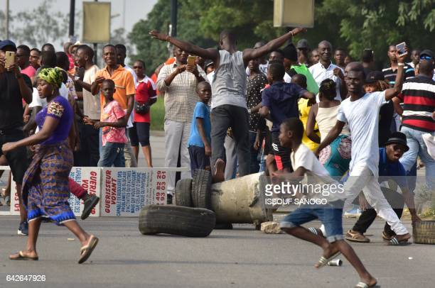 Angry subscribers who invested in agribusiness companies demonstrate on February 18 2017 in Abidjan after justice froze the assets of some 28...