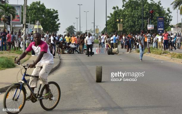 Angry subscribers who invested in agribusiness companies protest during a demonstration on February 18 2017 in Abidjan after justice froze the assets...