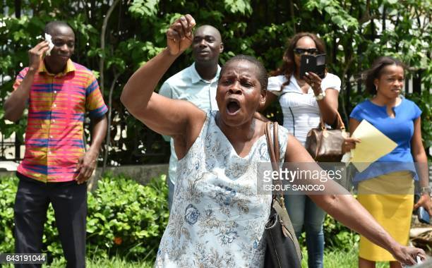 Angry subscribers who invested in agribusiness companies protest on February 20 2017 in Abidjan after justice froze the assets of some 28 companies...