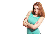 Displeased angry suspicious young woman isolated