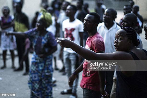 Angry voters at the SG Angola Libre school in the Makelele district of Brazzaville react while the ballots were counted in the polling station at the...