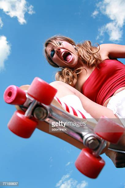 Angry woman about to stomp on her prey with her roller skate