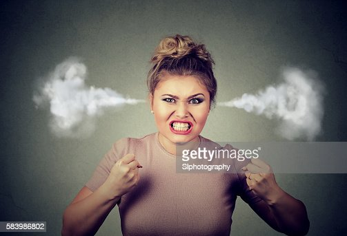 angry woman blowing steam coming out of ears : Stock Photo