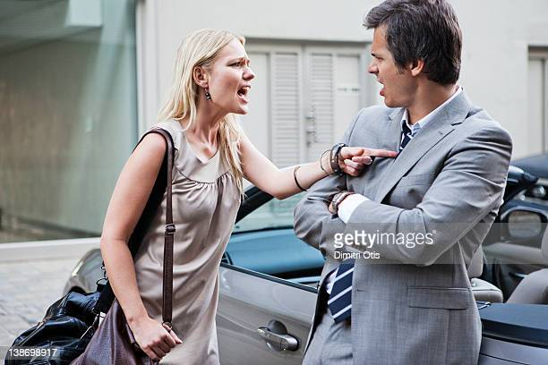 Angry woman shouting at man whist having argument