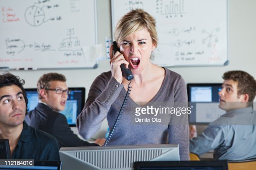 Angry woman shouting on the phone
