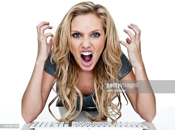 Angry woman using a computer