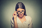 Headshot angry woman with glasses skeptically looking at you