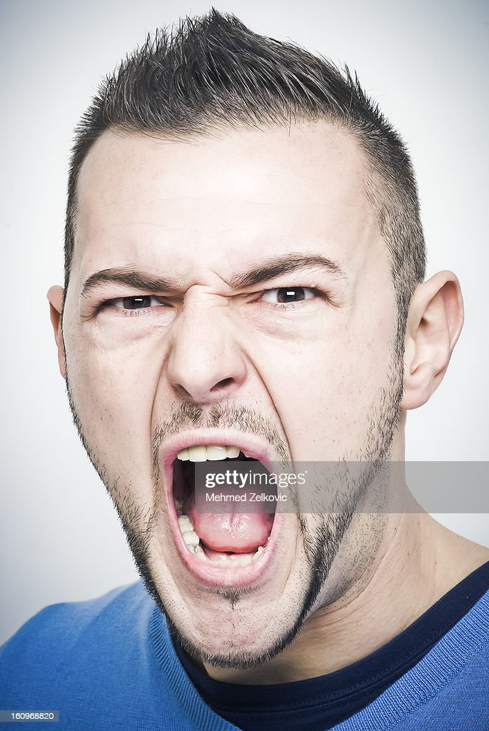 Angry young man : Stock Photo
