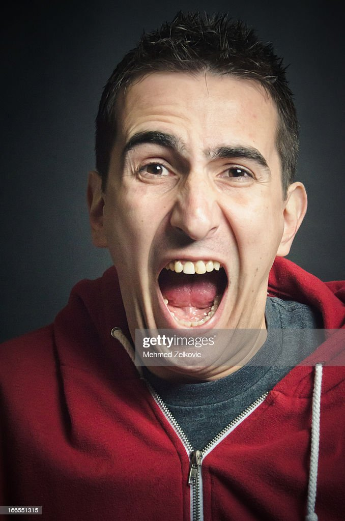 Angry Young Man Screaming Portrait
