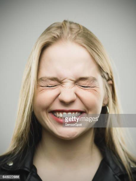 Angry young woman clenching teeth