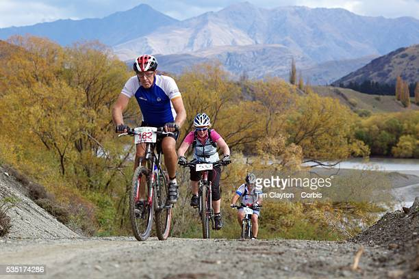 Angus Bradshaw Victoria Robertson and Shane Muir in action during the New World Tour de Wakatipu bike race on Saturday Six hundred and ninety people...