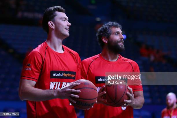 Angus Brandt and Matt Knight of the Wildcats look on while warming up during the round three NBL match between the Perth Wildcats and Melbourne...