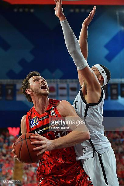 Angus Brandt of the Perth Wildcats tries to shoot as Josh Boone of Melbourne United defends during the round 17 NBL match between the Perth Wildcats...