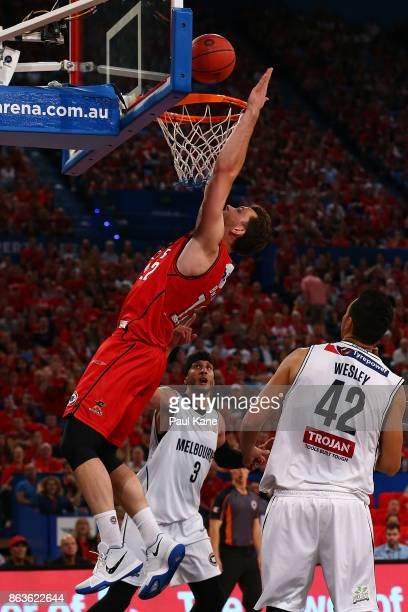 Angus Brandt of the Wildcats attempts to put the ball back in during the round three NBL match between the Perth Wildcats and Melbourne United at...