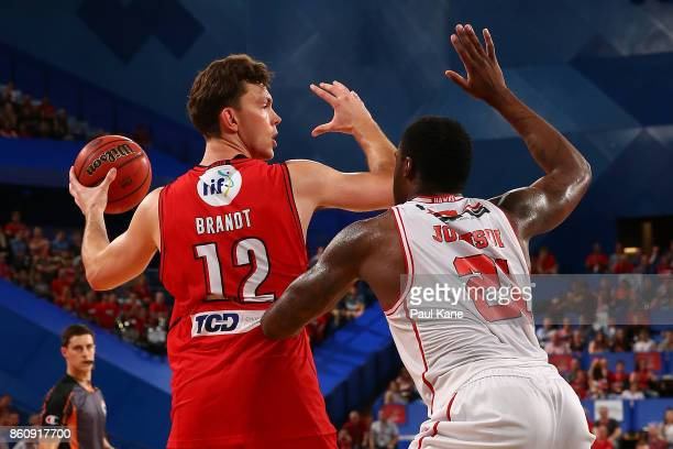 Angus Brandt of the Wildcats controls the ball against Delvon Johnson of the Hawksduring the round two NBL match between the Perth Wildcats and the...