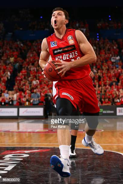 Angus Brandt of the Wildcats drives to the basket during the round three NBL match between the Perth Wildcats and Melbourne United at Perth Arena on...